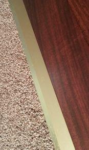 Metal Reducer transitioning from hardwood to carpet